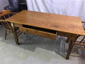 Oak Dining Room Table Wi th Two Riempies Chairs for sale.