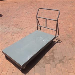 Flatbed 300 kgs EEZEEROLL trolley. Excellent condition. Locking mechanism on two sides.  (Retailing at R2,500 new)