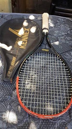 Black and orange kennex tennis racket