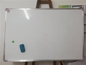 large white board with earser with markers