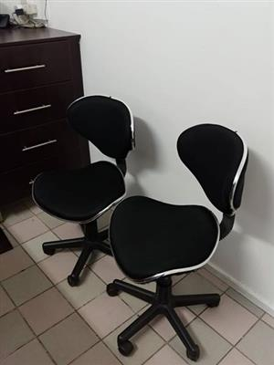 2 Black and silver office chairs with wheels