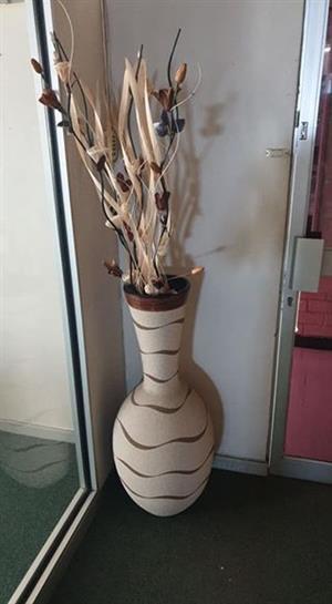 Large decorative vase with fake flowers