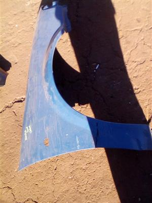Mazda 323 right fender