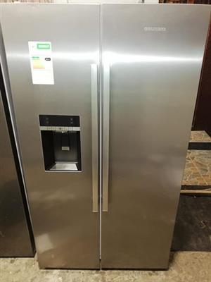Beautifull top class grundig side by side stainless steel water dispenser ice maker and ice crushder