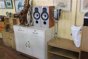 Speakers and 2 door white kitchen cabinet