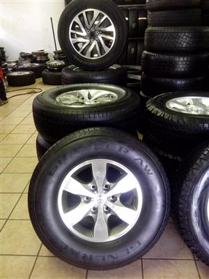 Toyota hilux diamond cut 16 inch with used 265/70/16 General Grabber R6000 x4 set.
