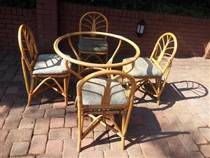 Round Cane table & 4 chairs with seat cushions – R3, 000