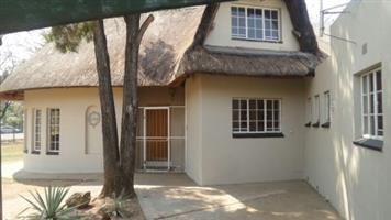 Double story thatch home