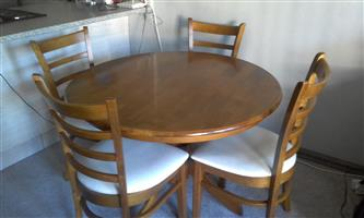 4 Seater round dining room set for sale