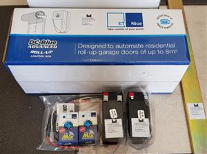 Roll Up Garage Door Motor Kit New Complete Batteries Remotes