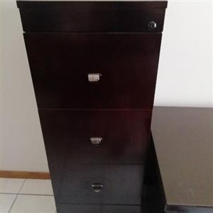 Dark wood office desk and filing cabinet