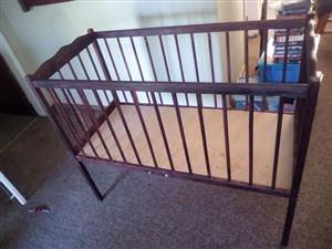 Wooden cot without mattress