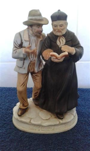 Priest and old man statue