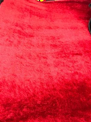 Bright red furry carpet for sale