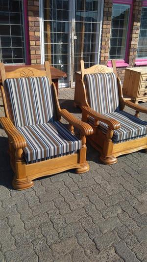 Wooden garden loungers with cushions