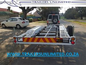 TRAILERS UNLIMITED DOUBLE AXLE CAR TRAILER. DOUBLE 1500KG AXLES.