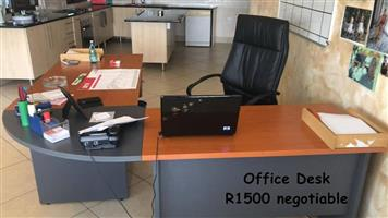 Grey and wooden corner office desk