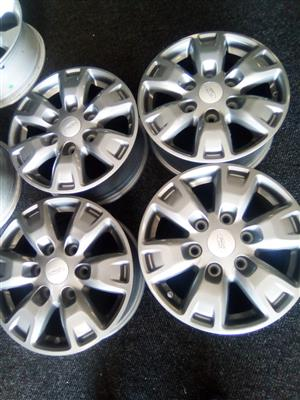 16 inch x4 new grey Ford mags.