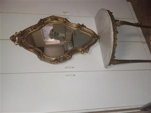 Wall table brass with white marble top and gold mirror for sale R4000.00 cash. Contact no 082-691-5791