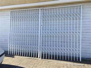 Large 2-part Trellidor security sliding gate - 320cm wide and 210cm high with key