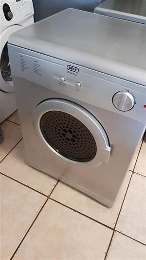 Silver Defy tumble dryer