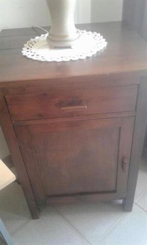 Dark wooden bedside cabinet