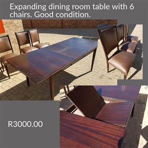 Expanding dining room table with 6 chairs