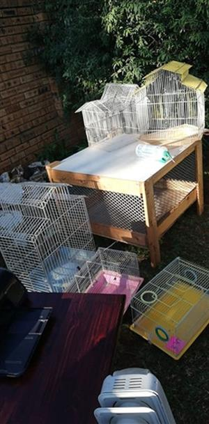 Various bird and hamster cages