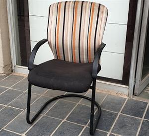 Pre-owned Visitors chair with orange stripped backrest/black seat