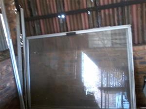Aluminium glass sliding door 2100mm x 4000mm . Used with rails etc complete .onco