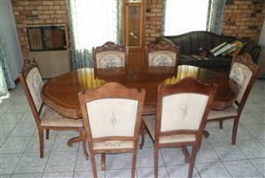 Dining room suite / eetkamer stel. 6 seater, carved wood..