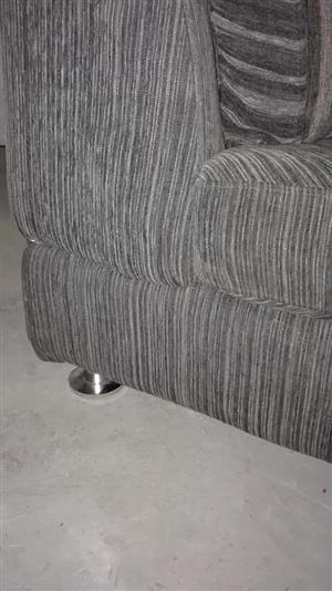 Grey ruffle couch for sale