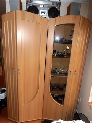 Two tall cupboards, one with glass door, R1500 for the pair