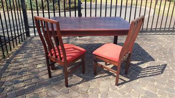 Wooden Diningroom table with 2 chairs