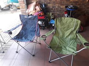 Dark blue and green camping chairs