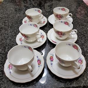 Porcelain cups and coursers set of 6