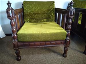 Dark wood lounge suite.