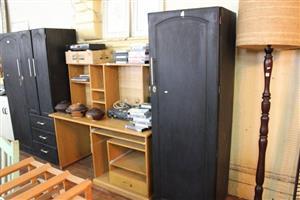 Single door dark wooden closet