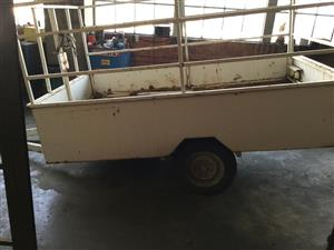 TRAILER WITH WINCH AND RAMPS