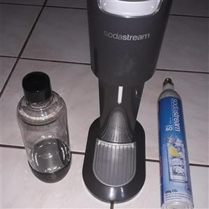 Sodastream sparkling water maker with bottle and CO2 cylinder