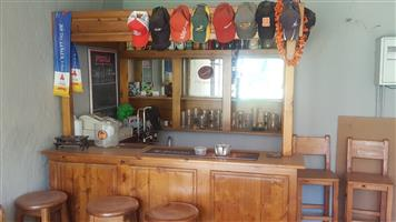 Home bar with back board, 5 chairs for R12000