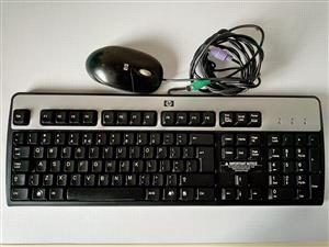 HP Keyboard and Mouse. Both wired. See the picture for more info.  I am in Orange Grove.