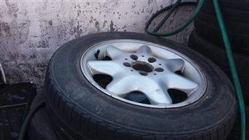 Mercedes rims 15 inch mags with tyres 60 percent life.