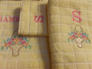 Embroidered towels and towel sets