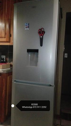 Silver Defy fridge with freezer