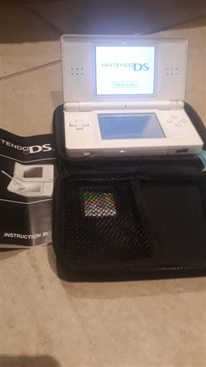 Nintendo DS Lite, charger + 2 games.  White.  Very good condition.