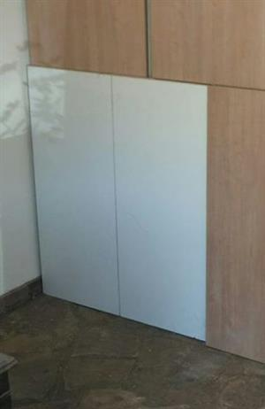 White cupboard with doors and small brown open cupboard together
