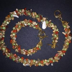 Exquisitely hand woven fresh water pearls&semi-precious stone set