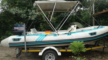Prestige 450 Inflatable with 50HP Yamaha and imported trailer