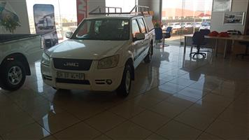 JMC Boarding Double Cab with canopy and roof rack.